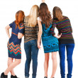 Back view of group beautiful women pointing at wall. - Stockfoto