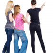 Back view of group beautiful women pointing at wall. - Foto Stock