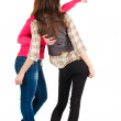 Back view of two young woman  pointing at wall . — Stock Photo