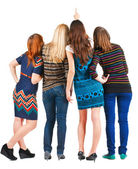 Back view of group beautiful women pointing at wall. — Foto Stock