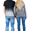 Foto Stock: Back view of young couple look into distance.