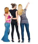 Back view of group beautiful women pointing at wall — ストック写真
