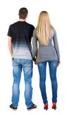Back view of young couple look into the distance. — Stock Photo