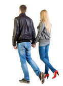 Back view of going young couple — Foto Stock