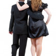 Royalty-Free Stock Photo: Back view of going young business couple