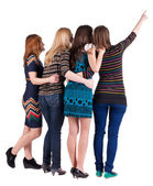 Back view of group beautiful women pointing at wall. — ストック写真