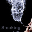 "Photo: Concept ""smoking kills"". Isolated on black background"