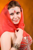 Woman in a red scarf — Stock Photo