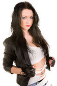 Young woman with black hair in a leather jacket and a fragmentar — Stock Photo