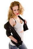 Beautiful woman takes off leather jacket — Stock Photo