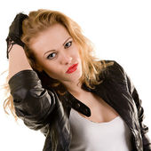 Portrait of a beautiful woman in a leather jacket and gloves — Stock Photo