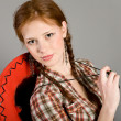 Girl in a checkered shirt — Stock Photo