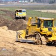 Bulldozer and truck work — Stock Photo