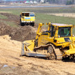 Bulldozer and truck work — Stock Photo #8152382