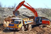 Backhoe loader loading dumper — Stock Photo