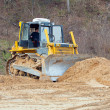 Royalty-Free Stock Photo: A yellow bulldozer working