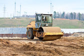 Yellow steamroller on a construction site — Stock Photo