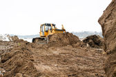 A yellow bulldozer working — Stock Photo