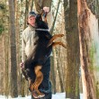 Photo of man holding stick over jumping dog — Stock Photo