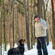 Dog of breed a Rottweiler on walk with the owner in the winter — Stock Photo #9088478