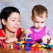The child in a pink dress with toys — Stock Photo #9925257