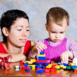 Stock Photo: The child in a pink dress with toys