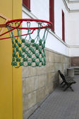 Basketball against a background of an empty school yard — Stock Photo