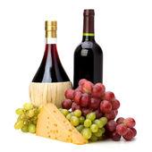 Full red wine bottles — Stock Photo