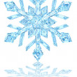 Light blue crystal snowflake on glossy white - Stock Photo