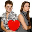 Funny nerd guy gives a valentine glamorous girl isolated on whit — Stock Photo