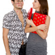 Stock Photo: Funny guy nerdy and glamorous girl in a Valentine's Day
