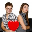 Funny nerd guy gives a valentine glamorous girl — Stock Photo