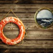 Lifebuoy and porthole — Stock Photo
