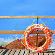Sea and pier with life buoy - Stockfoto
