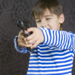 Boy with a weapon — Stock Photo