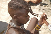 Little himba boy prepare some food — Stockfoto