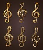 Vector set of golden decorative treble clef — Stock Vector