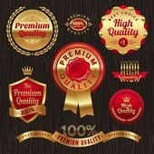 Set of golden quality labels and emblems — Stock Vector
