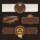 Vector set of leather & golden framed labels — Stok Vektör