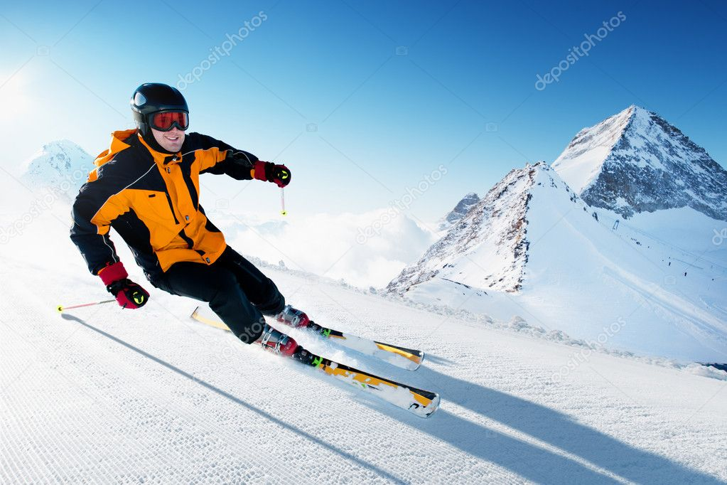 Skier in mountains, prepared piste and sunny day — Stock Photo #9290922