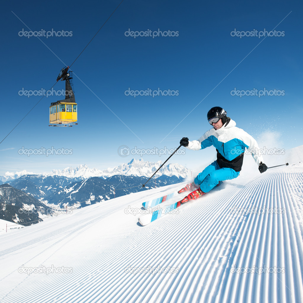 Skier in mountains, prepared piste and sunny day — Stock Photo #9290945