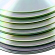 Stack of compact discs on white background — Stock Photo