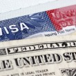 European Union passport, dollars and US visa - Stock Photo