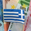 Euro banknotes and Greek flag — Stock Photo #8510280