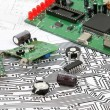 Electronic circuit boards on the background of electronic scheme — Stock Photo