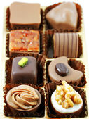 Box of assorted chocolates on white background — Stock Photo