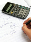 Scientific calculator on notebook paper — Stock Photo