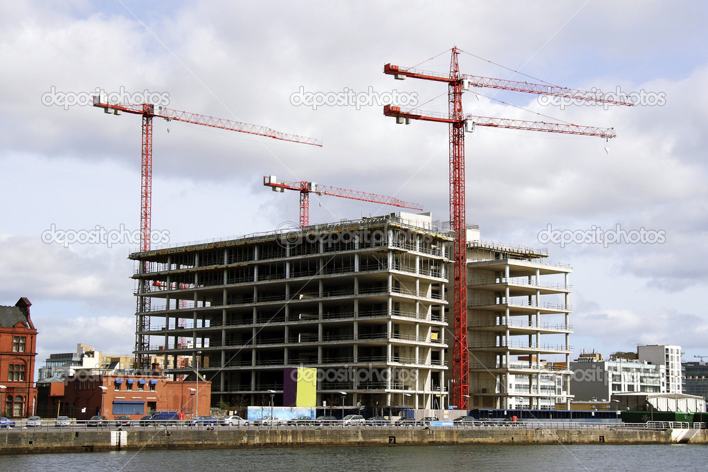 Building cranes  and building house , Dublin, Ireland — Stock Photo #8510216