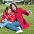 Mother and daughter having fun in the park. — Stock Photo
