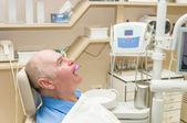 Older man in dentist — Stock Photo